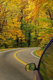 Autumn Colors. Road leading through autumn colors stock photography