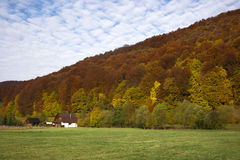 Autumn colors. House on the countryside in late autumn Stock Photos