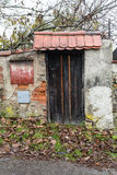 Autumn colors around the front door of a Rustic English Cottage Royalty Free Stock Photography