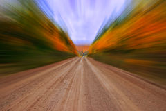 Autumn colors country dirt road zooming effect Stock Image