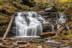 Autumn Colors at F.L. Ricketts Falls in Ricketts Glen State Park of Pennsylvania royalty free stock photo