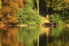 Autumn Colors at Lake. Autumn colors and reflections at Lake in The Netherlands royalty free stock photography