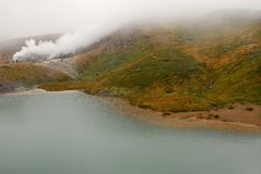 Autumn colors lake fog Stock Photo