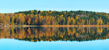 Autumn colors at a lake with reflections - Panorama Royalty Free Stock Images