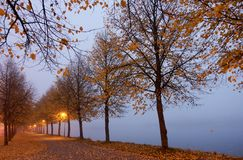 Autumn colors and misty lake in Hameenlinna, Finland royalty free stock images