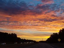 End of the day. And all people heading home. The beautiful colors of an October sunset in New England Stock Images
