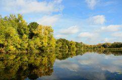 Autumn Colors Reflected on a Lake. On a Calm Royalty Free Stock Image