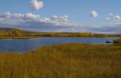 Autumn colors surround a lake Royalty Free Stock Photos
