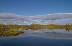Autumn colors surround a lake Stock Photo