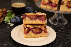 Cake with almonds and plums. Autumn colors, sweet and bitters aromas from the kitchen, made me to prepare this cake with almonds and plums Royalty Free Stock Photography