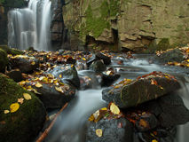 Autumn coloured valley and waterfall Royalty Free Stock Photography