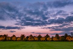 Autumn colours at dawn on Harrogate Stray. Autumn colours under a pink and blue dawn sky on Harrogate Stray royalty free stock image