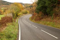 Autumn colours on a Welsh country road Royalty Free Stock Photography