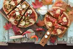 Autumn comfort food. Flatlay of homemade wholegrain pizzas with stock photography