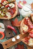 Autumn comfort food. Pizzas with eggplant, mozarella and salami stock photo