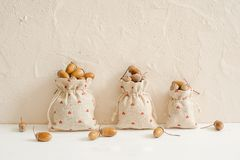 Autumn composition with acorns in linen bags. Autumn, fall concept. Copy space. royalty free stock image