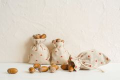 Autumn composition with acorns in linen bags. Autumn, fall concept. Copy space. royalty free stock photos