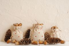 Autumn composition with acorns in linen bags and pine cones. Autumn, fall concept. Copy space. royalty free stock photos