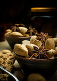 Autumn composition of almonds on a dark rustic background with s Stock Image