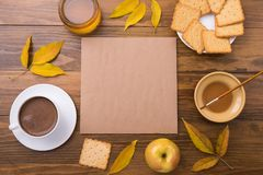 Autumn composition with coffee and leaves Stock Images