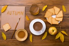 Autumn composition with coffee and leaves Stock Photography