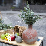 Autumn composition decorating  counter. Apples, quinces and lemons, together with eucalyptus and daisies on the table Stock Photos