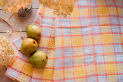 Autumn composition. Dried hydrangea, pears on a linen napkin. On a wooden background. Place for your inscription Stock Photo