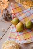 Autumn composition. Dried hydrangea, pears on a linen napkin. On a wooden background. Stock Photos
