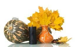 Autumn composition, dry leaves, pumpkin, candle on white royalty free stock images