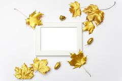 Autumn composition. Frame made of autumn golden leaves on light grey background. Flat lay, top view, copy space royalty free stock photos