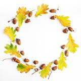 Autumn composition. Frame made of autumn leaves and pine cones on white background. Flat lay, top view, copy space. Autumn composition. Frame made of autumn Stock Photo