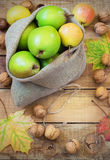 Autumn composition of fruits, nuts and spices - pears, walnuts, maple leaves Stock Photos