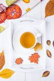 Autumn composition. Herbal tea and autumn gingerbread in the form of maple leaf and acorn on a white background. Top Royalty Free Stock Photos
