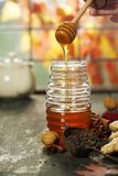 Autumn composition with honey. Warm and comfy autumn concept. stock photo