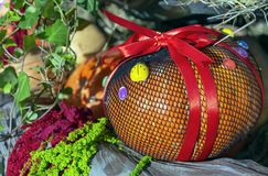 Autumn composition with pumpkins in gift wrapping stock image