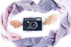 Autumn composition. Retro camera, autumn leaves and scarf on a white background. Nostalgia for autumn. The view from the. Top Stock Photos