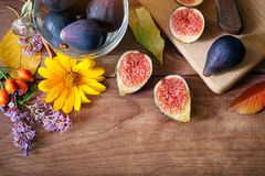Autumn composition - ripe figs and flowers. fruits and vegetables Royalty Free Stock Image