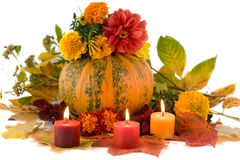 An autumn composition shot over white. An autumn composition with pumpkin, flowers, leaves and candles shot over white Royalty Free Stock Photo