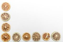 slices of dried oranges on a white background stock images