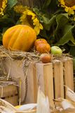 Autumn composition with yellow melon, sunflowers and apples, selective focus, vertical royalty free stock photo