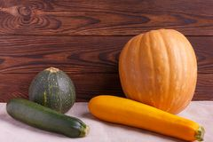 Autumn concept of vegetables on a brown wooden background royalty free stock photography