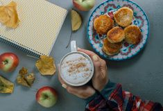 Autumn concept. Woman hands with cup of coffee,  notebook, leave Royalty Free Stock Photos