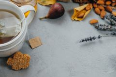 Autumn coposition: Herbal tea, almonds, grapes, honey, figs, dry Stock Photography