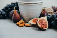 Autumn coposition: Herbal tea, almonds, grapes, honey, figs, dry Royalty Free Stock Image