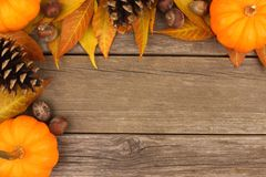 Autumn corner border against rustic wood Royalty Free Stock Photos