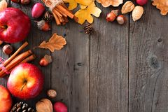 Autumn corner border of apples and fall ingredients over wood Royalty Free Stock Image