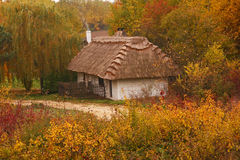Autumn cottage. A wooden cottage situated in an open air museum of village architecture in Tokarnia outside Kielce, Poland Stock Images