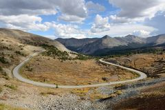 Autumn at Cottonwood Pass. Autumn view of the scenic mountain road near the summit (12,126 ft / 3,696 m) of the Cottonwood Pass -- a high mountain pass between royalty free stock image