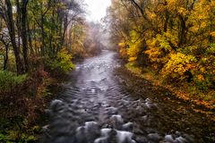 Autumn country and long exposure river Stock Photography