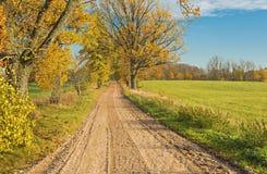 Autumn country road, Latvia Stock Photos